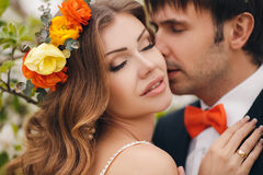 The bride and groom in a lush Park in the spring. Royalty Free Stock Photo