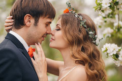 The bride and groom in a lush Park in the spring. Stock Photo