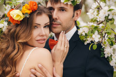 The bride and groom in a lush Park in the spring. Stock Images