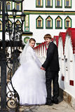 Bride and groom about the luxurious palace Stock Photo