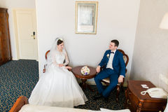 Bride and groom in a luxury vintage interior room on their wedding. Stock Images