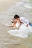 Wedding on beach. Bride and Groom lying in beach shore Royalty Free Stock Photos