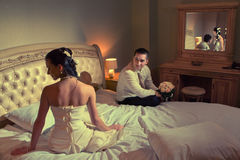 Bride and groom lying on bed Stock Photo