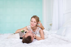 Bride and a groom lying on the bed. Royalty Free Stock Image