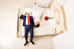 Bride and a groom lying on the bed Royalty Free Stock Image