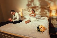 Bride and groom lying on bed Royalty Free Stock Photos