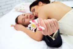 Bride and groom lying in bedroom close up Stock Photography