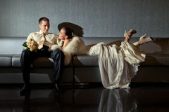 Bride and groom lying in a stylish lounge Stock Photo