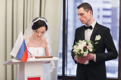 Bride and groom on marriage registration Stock Photography