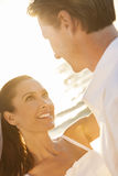 Bride and Groom Married Couple Sunset Beach Wedding. A married couple, bride and groom, together in sunset sunshine on a beautiful tropical beach Royalty Free Stock Images