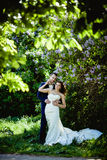Bride and groom in May Stock Image