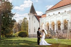 Bride and groom meet in front of the old mansion, romantic, nost. Algic scene with sunshine Stock Image