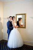 Bride and groom by the mirrir Stock Photography