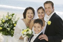 Bride and Groom with mother and brother outdoors (portrait) Royalty Free Stock Photos