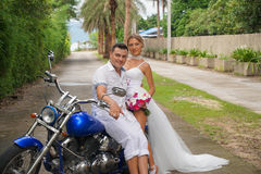 Bride and Groom on Motorcycle Royalty Free Stock Image