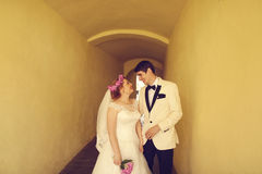 Bride and groom on a narrow street Stock Images