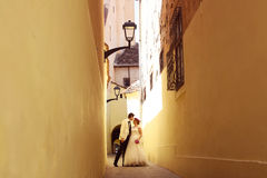 Bride and groom on a narrow street Stock Image