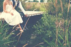 Bride and groom in nature Royalty Free Stock Images