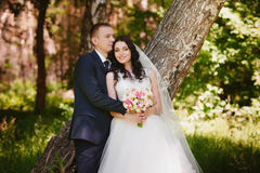 The bride and groom in nature, decor, peonies, flowers, lifestyle, marriage, family, love Royalty Free Stock Images