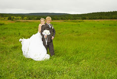 Bride and groom on nature in field Stock Photo