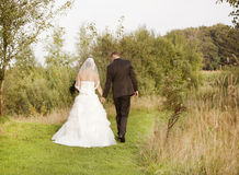 Bride and groom in nature Stock Photos