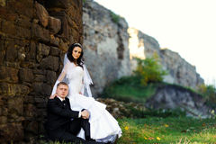 Bride and groom near ancient castle Stock Image