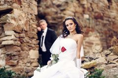 Bride and groom near ancient castle Royalty Free Stock Photography