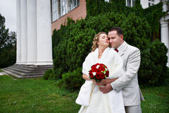 Bride and groom near ancient palace Royalty Free Stock Images