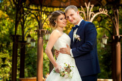 Bride and groom near arbor portrait. Bride and groom together near decorative arbor portrait Royalty Free Stock Images