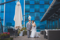 Bride and groom near the building Stock Photo