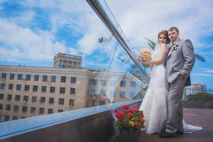 Bride and groom near the building Royalty Free Stock Photo