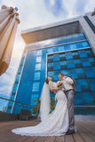 Bride and groom near the building Stock Photography