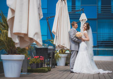 Bride and groom near the building Royalty Free Stock Images