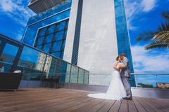 Bride and groom near the building Stock Image