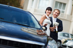Couple by the car Stock Images