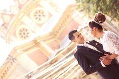 Bride and groom near church Stock Photos