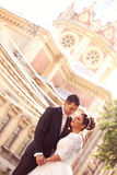 Bride and groom near church Stock Photo