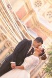 Bride and groom near church Royalty Free Stock Photos