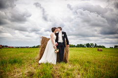 Bride and groom near hay Royalty Free Stock Photography