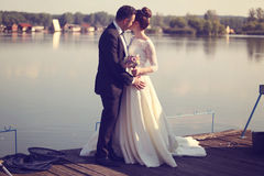 Bride and groom near lake Royalty Free Stock Image