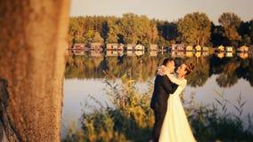 Bride and groom near lake Royalty Free Stock Photo