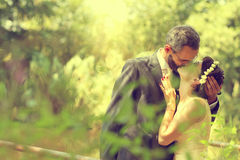 Bride and groom near lake surrounded by nature Royalty Free Stock Images