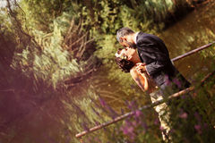 Bride and groom near lake surrounded by nature Stock Photography