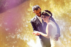 Bride and groom near lake surrounded by nature Royalty Free Stock Photos
