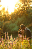 Bride and groom near lake surrounded by nature Stock Photos