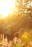 Bride and groom near lake surrounded by nature Stock Image