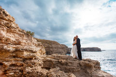Bride and groom near the ocean. Hugging each other Royalty Free Stock Photography