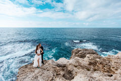 Bride and groom near the ocean. Hugging each other Stock Photography