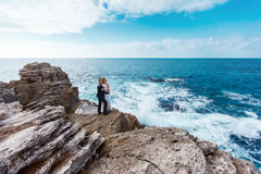 Bride and groom near the ocean. Hugging each other Royalty Free Stock Images