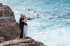 Bride and groom near the ocean. Hugging each other Royalty Free Stock Photo